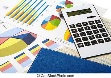 Calculator and diagrams on a business background