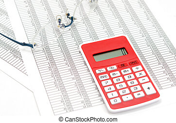 Calculator and glasses and Accounting documents