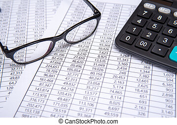 calculator and glasses on financial chart, business concept.
