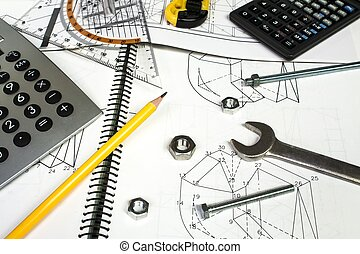 calculator and measuring equipment with nuts on technical drawing