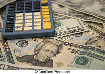 Calculator and money - Calculator on a pile of money