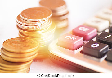 calculator and money coins, concept in growth, save and investment in business