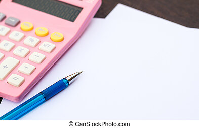 Calculator and pen on white paper.