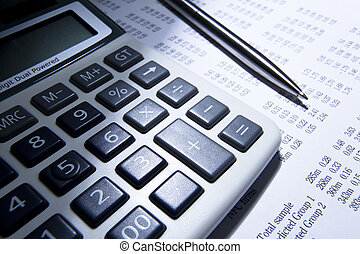 calculator and pen over business numbers