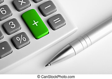 calculator and pen. plus button colored green