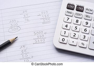 Calculator and pencil on note paper with calculation concept select focus
