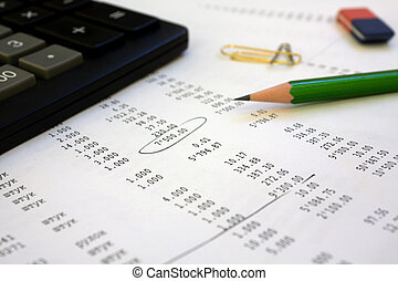 calculator and pencil on the financial report