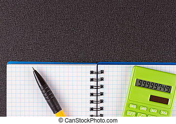 Calculator and pencil on wood background