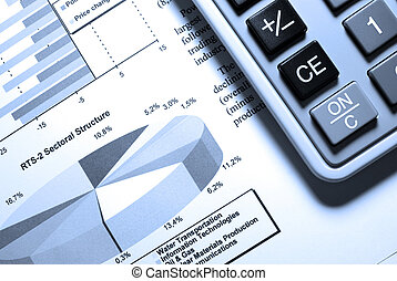 Calculator and printed stock data with diagrams.
