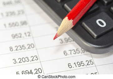 calculator and red pen on the background of financial...