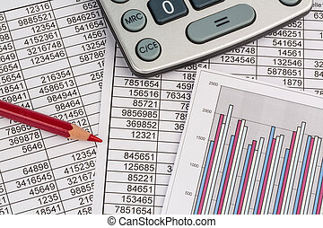 calculator and statistk - a calculator is on a balance sheet...
