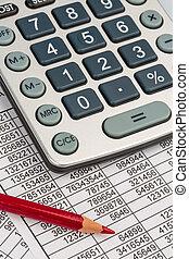 calculator and statistk - a calculator is on a balance sheet...