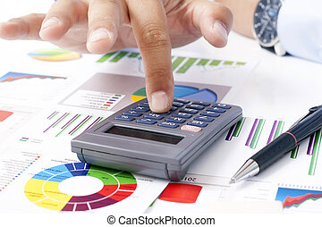 Calculator and Tax Returns - Stock Image
