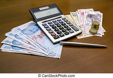 calculator, coins and paper banknotes.