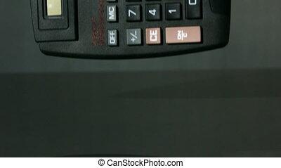 Calculator falling on black background