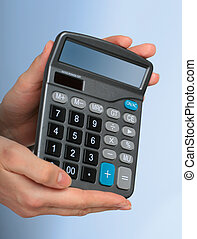 Calculator in hands.