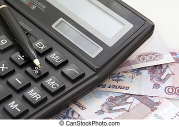 Calculator, money and black pen