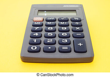 Calculator on a yellow background