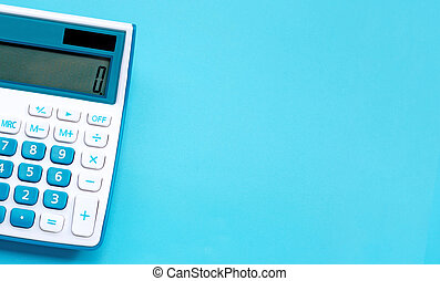 Calculator on blue background, top view