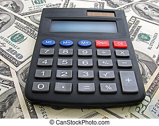 calculator on heap of dollars