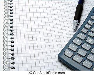 Calculator on open notebook