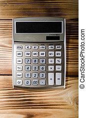 Calculator on the wooden background