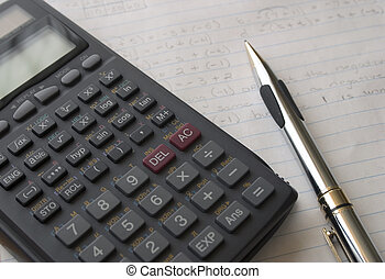Calculator & Pencil - A calculator and pencil sitting on...