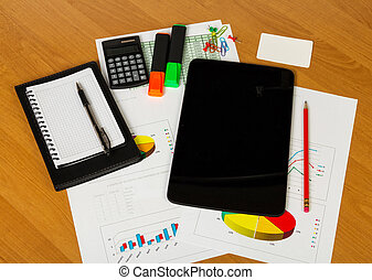 Calculator, tablet, notebook and other stationery to desktop background.