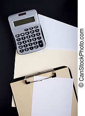 Calculator with office paper