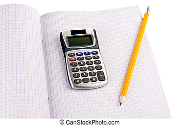 Calculator with pencil on squared paper isolated over white