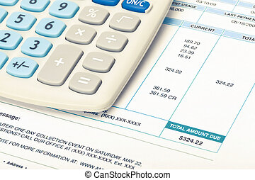 Calculator with utility bill under it