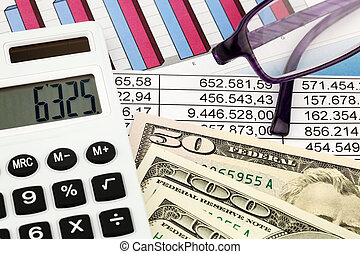 Calculators and Statistics - A calculator and dollar bills...