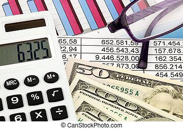 Calculators and Statistics - A calculator and dollar bills...