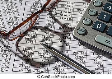 calculators and statistics - a calculator is on a balance...