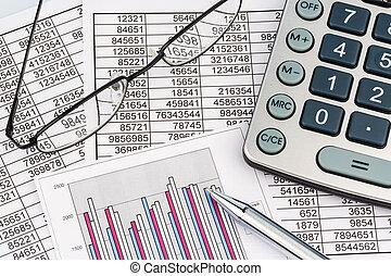 calculators and statistk - a calculator is on a balance...