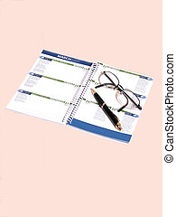 Calendar 50831 - A calendar note pat with a pen and an ...