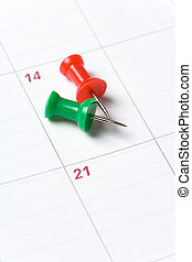 Calendar and Thumbtack close up shot for background