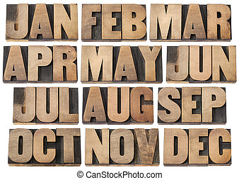 calendar concept - months in wood type - 12 months from...