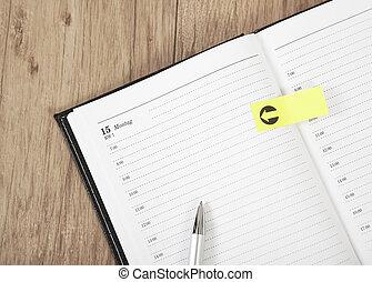 Calendar empty - an open blank calendar with Post it...