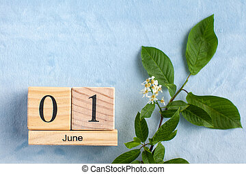 Calendar June 1 on a blue background with flowers. The concept of the beginning of summer, Children's Day. Copy space