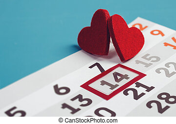 Calendar page with the red hearts on February 14.