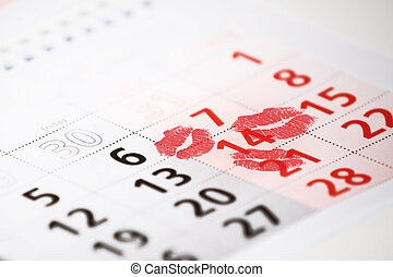 Calendar page with the red kisses on February 14 of Saint Valentines day.