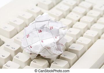 Calendar paper ball and computer keyboard