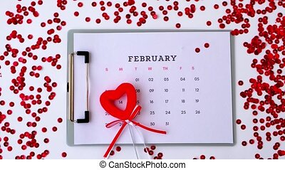 Calendar with 14th of February date. Planning Valentines day holiday. Love romantic dating. Preparing with hearts. Candles romance