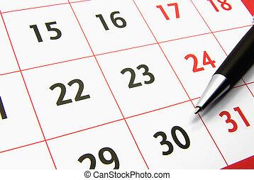 Calendar with a pen 2 - Detail view of a typical calendar ...