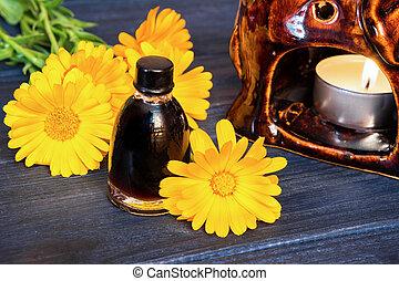 Calendula oil in a glass bottle