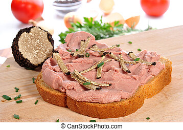 calf liver sausage on bread with grated summer truffle