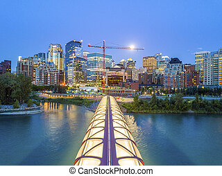 Calgary downtown with iluminated Peace Bridge, Alberta, Canada