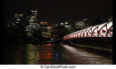 This is a night time lapse scenic featuring downtown Calgary, Peace Bridge, and the Bow River