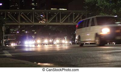 Downtown Calgary Summer night traffic flows under a sky bridg